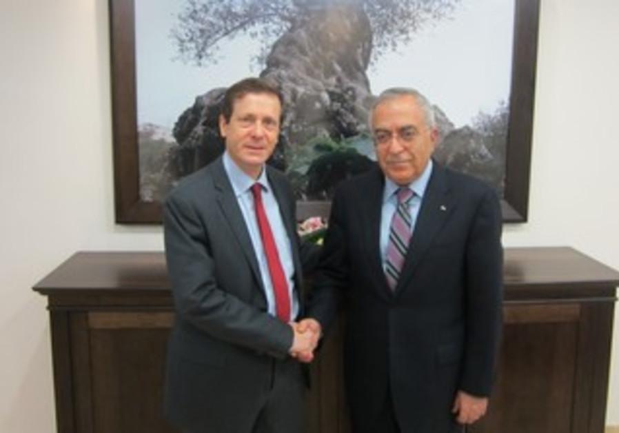 Labor MK Issac Herzog and PA Prime Minister Salam Fayyad meet in Ramallah, Feb 4, 2013