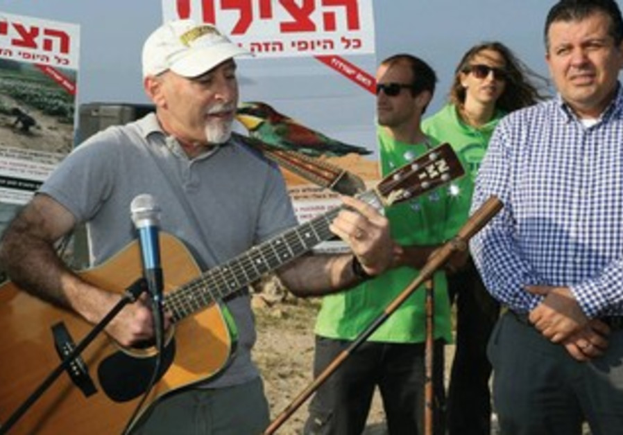 ENVIRONMENTAL ACTIVISTS, led by Green Party head Alon Tal, hold a protest along the Palmahim Beach