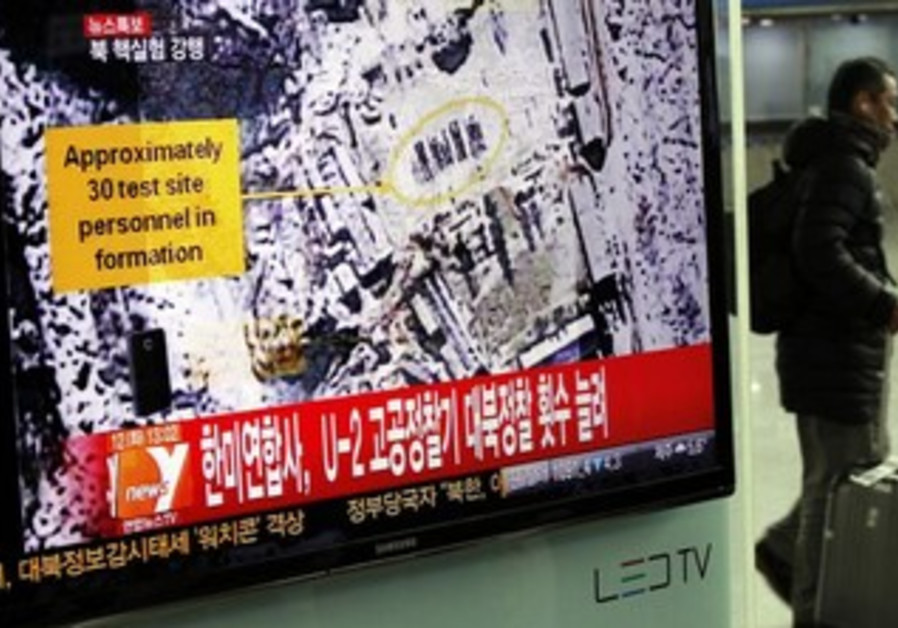report on North Korea's nuclear test at a railway station in Seoul February 12, 2013