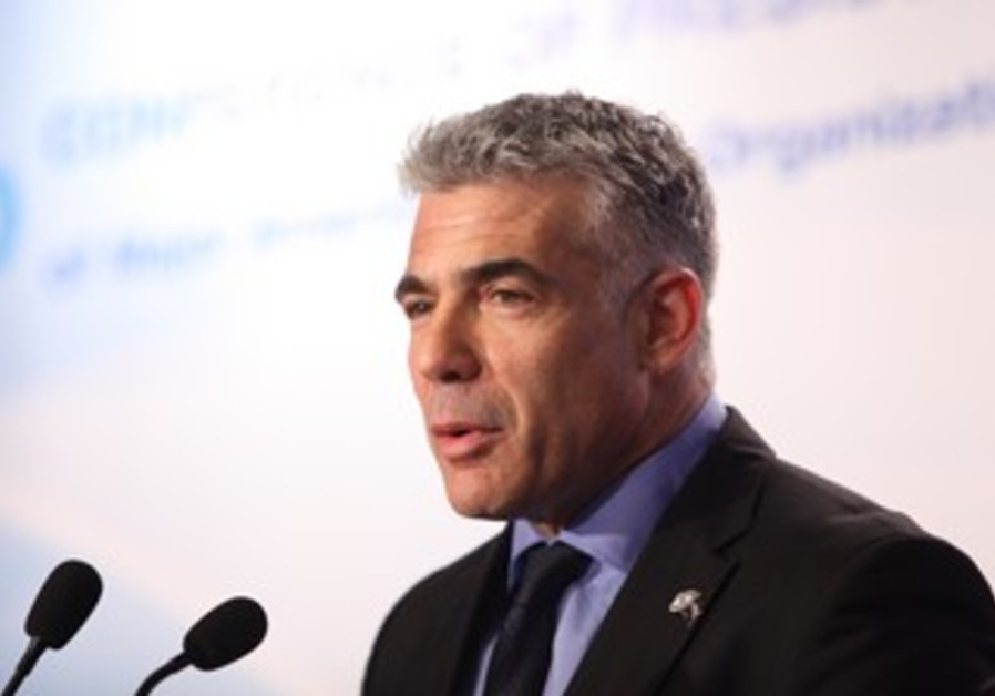 Yesh Atid leader Yair Lapid addresses Conference of Presidents, Feb 12