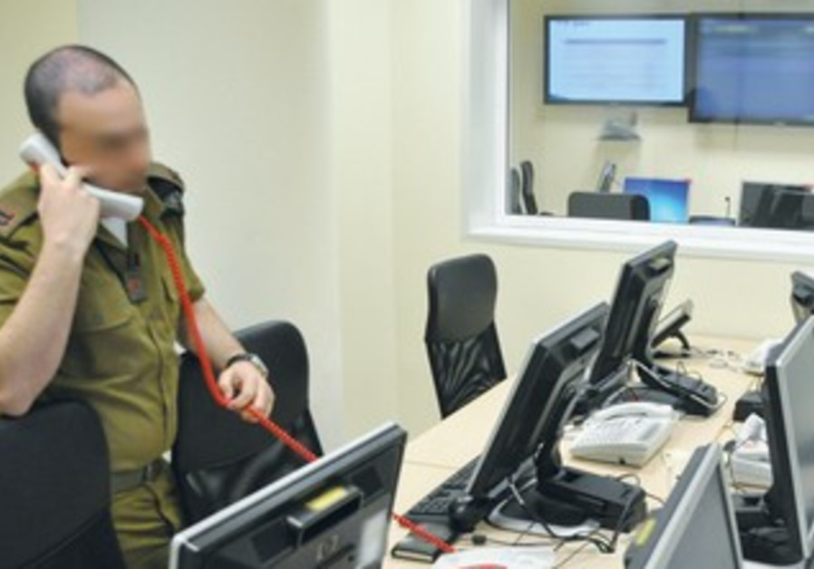 An officer speaks on the phone at the new IDF cyber-defense control center.