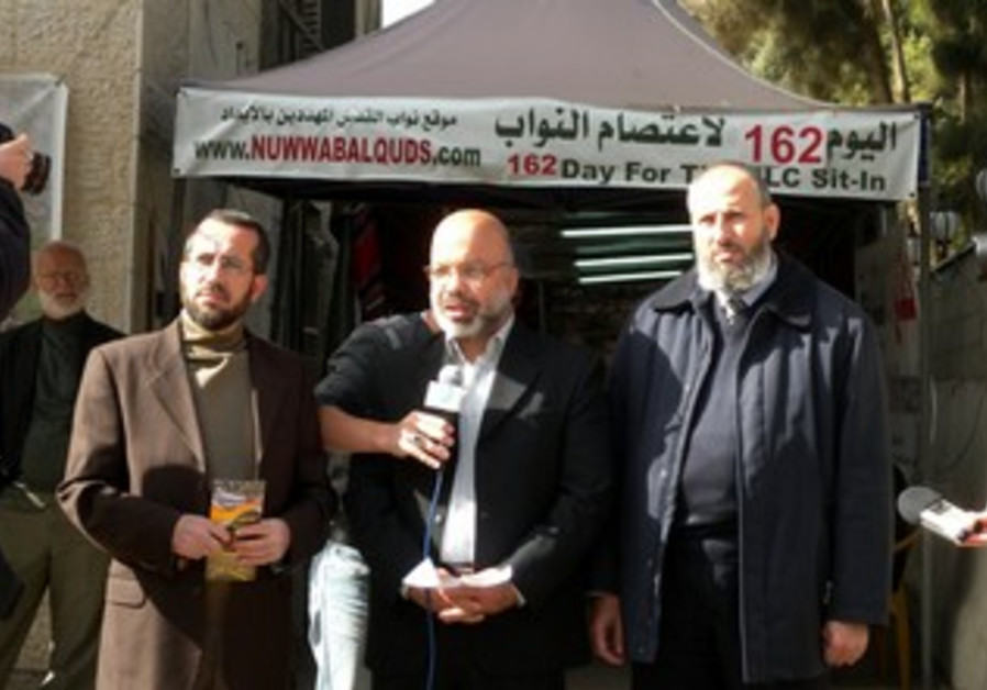 from left to right: Khaled Abu-Arafeh, Ahmad Attoun, and Muhammad Totah give a press conference