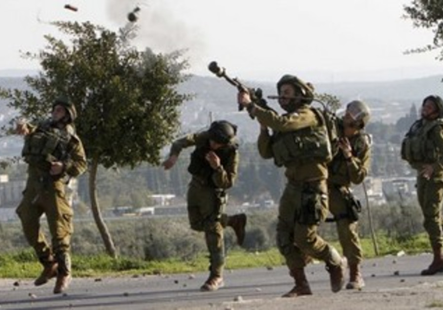 Israeli soldiers fire tear gas towards stone-throwing Palestinians [FILE]