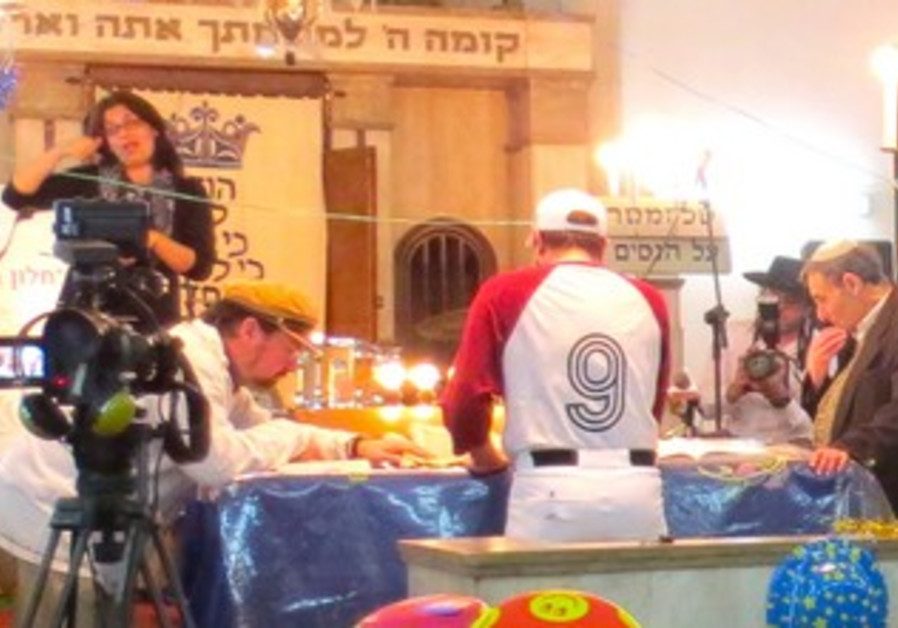 Sign reading Megilat Esther.