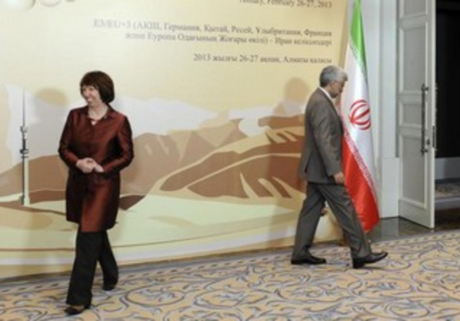EU foreign policy chief Ashton (L) and Iran nuclear negotiator Saeed Jalili in Kazakhstan, Feb. 26
