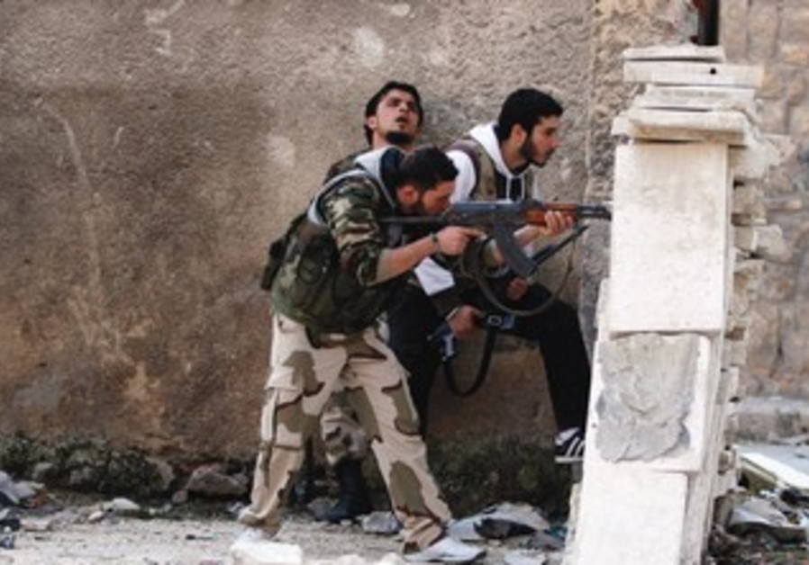 MEMBERS OF A Syrian opposition group are seen on the front lines in Aleppo