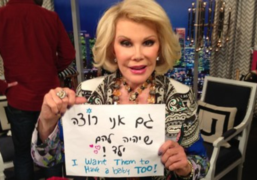 Joan Rivers holding sign supporting LGBT rights in Israel