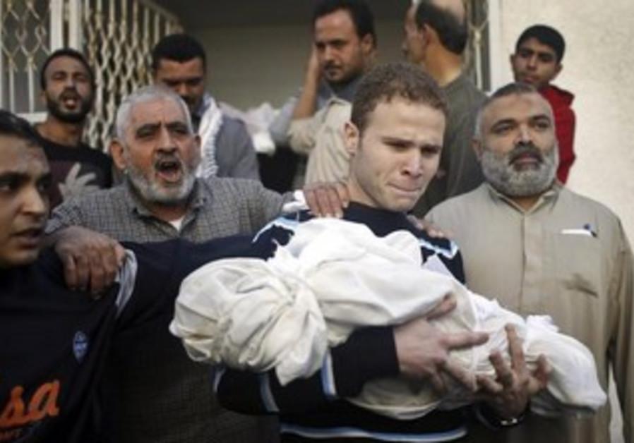 Jihad al-Masharawi with his 11-month-old son Omar, who awas killed in Gaza November 15, 2012.
