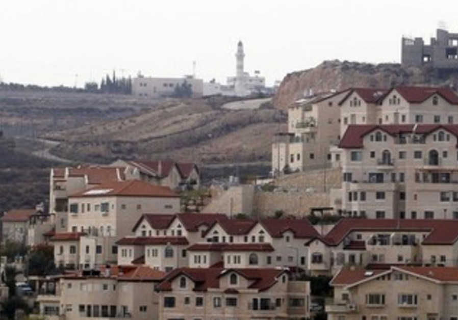 Mosque in Abdullah Ibrahim behind houses in West Bank Jewish settlement of Efrat, December 2011.