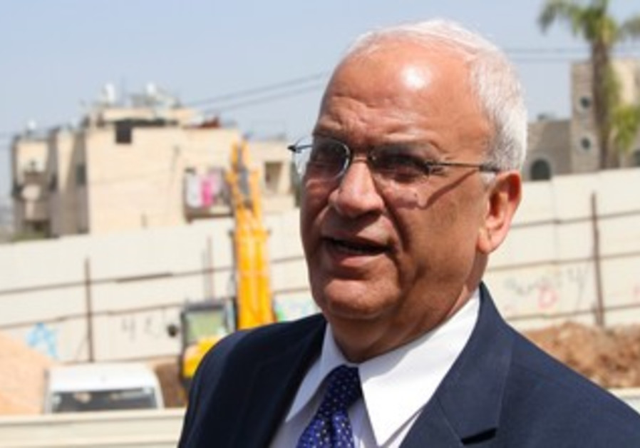 Palestinian negotiator Saeb Erekat at construction site for Route 4, March 14, 2013.