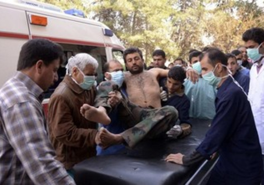 Residents move a Syrian Army soldier, wounded in apparent chemical weapon attack, March 19, 2013.
