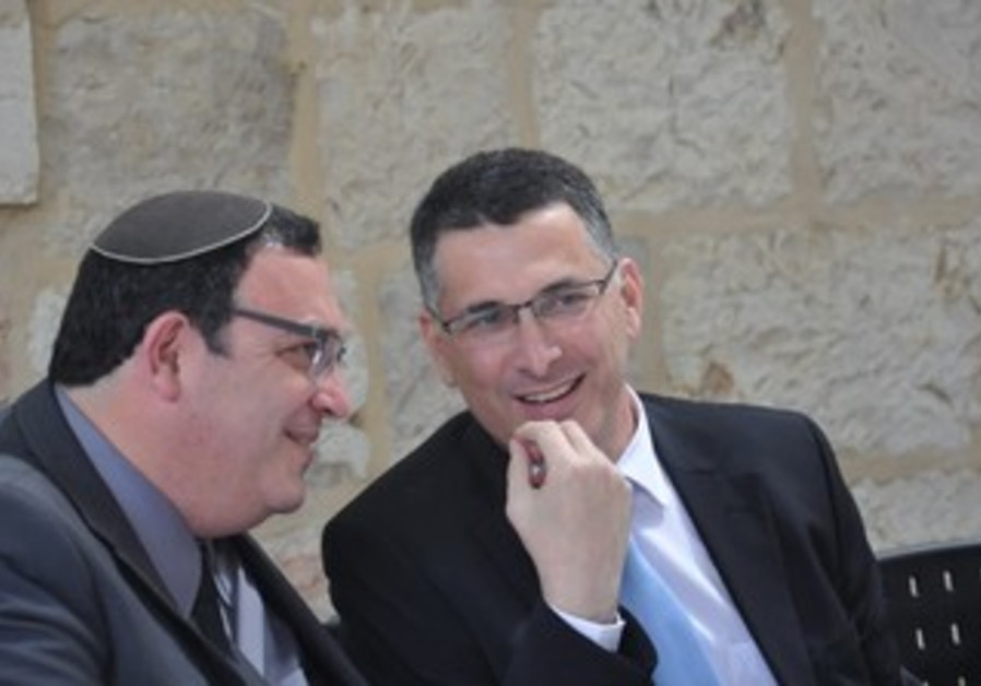 Gideon Sa'ar (R) hands over education Ministry to Shai Piron