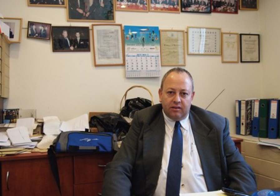 JABAR HUSSEIN sits in his office at the Jerusalem  Ramada Renaissance Hotel