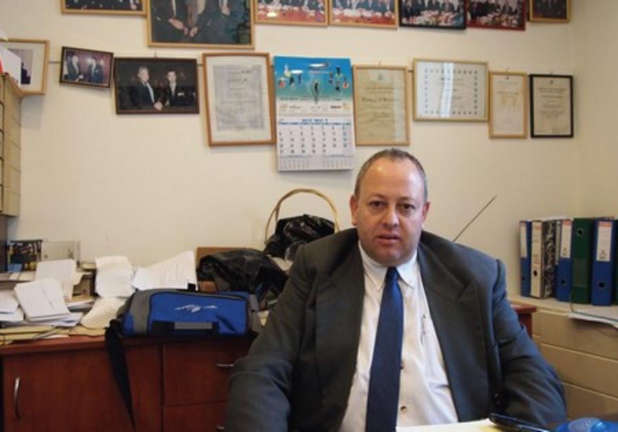 JABAR HUSSEIN sits in his office at the Jerusalem  Ramada Renaissance Hotel