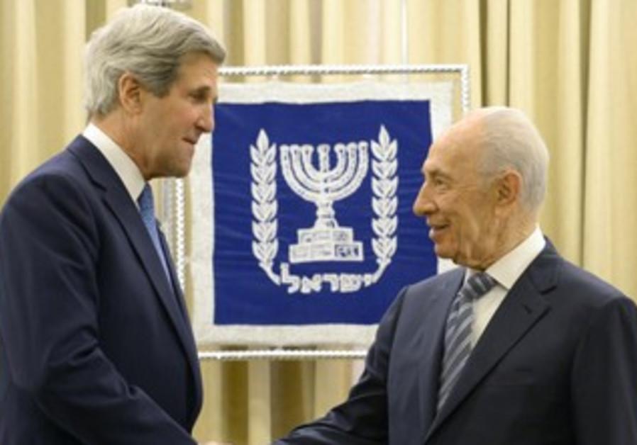 President Shimon Peres greets US Secretary of State John Kerry in Jerusalem, April 8 2013