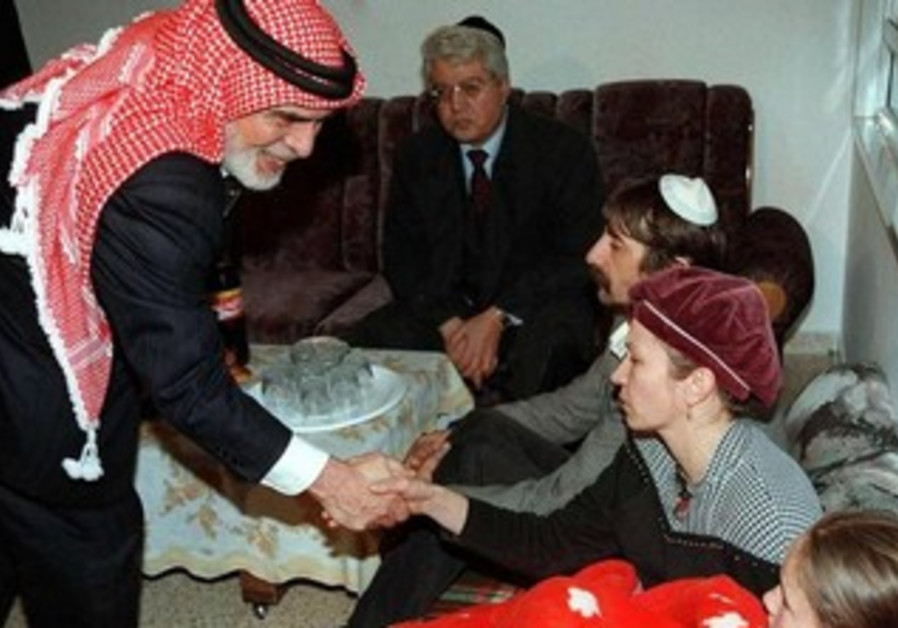 Jordan's King Hussein visits grieving families of Island of Peace masscre victims, March 16, 1997.