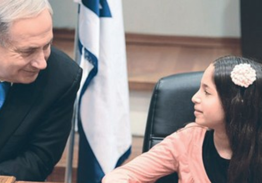 PRIME MINISTER Binyamin Netanyahu meets with the orphan of a fallen soldier.