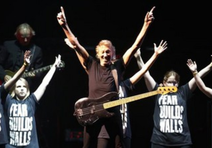 Roger Waters playing at a concert in Quebec