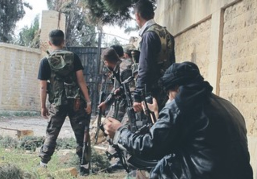 Syrian rebels take up positions during clashes with forces loyal to President Assad near Aleppo.