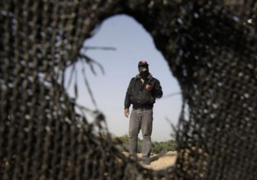 Palestinian man inspects the damage left by an IAF missile strike in Gaza.