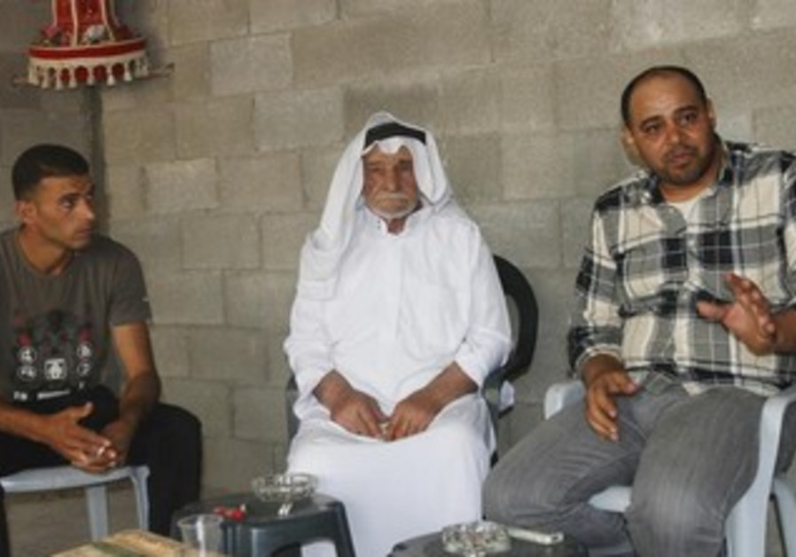 Assad Zaghal (C), father of Salam, a 21-year-old Palestinian who killed an Israeli in the West Bank