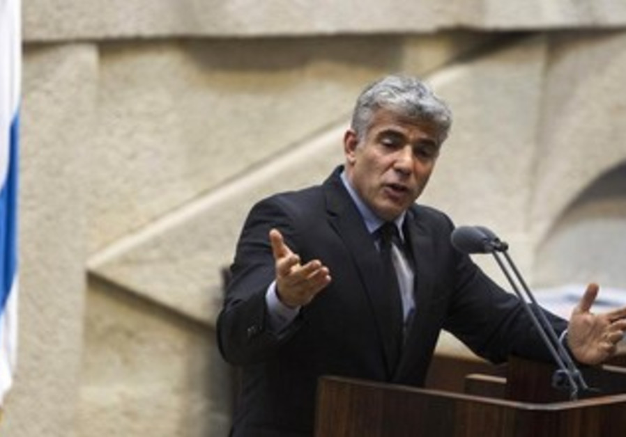 Yair Lapid addresses the Knesset.