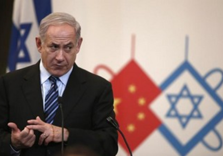 Prime Minister Binyamin Netanyahu gives a speech during a gala dinner in Shanghai , May 6