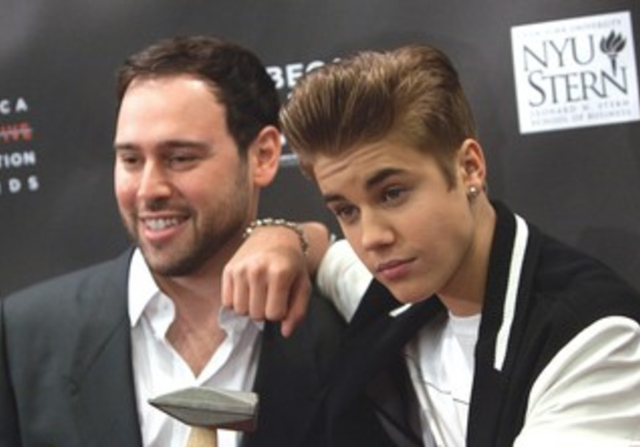JUSTIN BIEBER and Scooter Braun attend an awards ceremony in New York