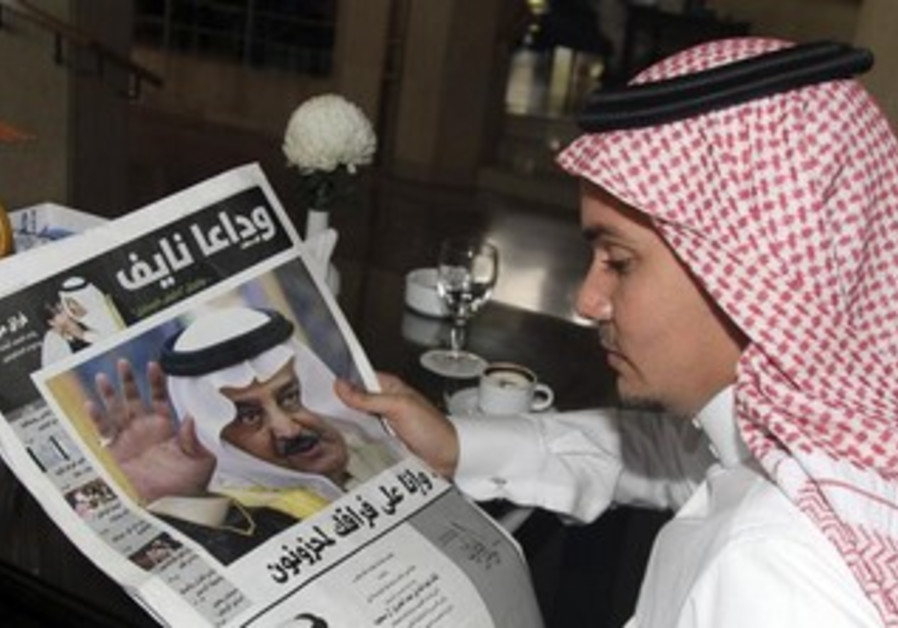 A man reads a newspaper in Jeddah June 17, 2012
