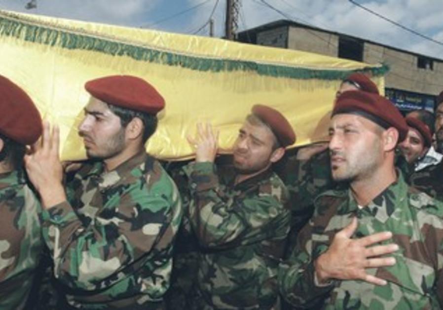 Hezbollah members at funeral of a Hezbollah fighter, May 25, 2013
