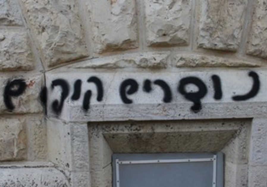 """""""Christians are apes"""" written on the wall of the Dormition Abbey in Jerusalem, May 31, 2013."""