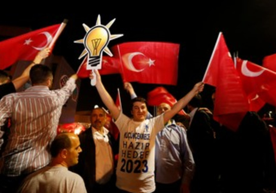 Supporters of Turkish Prime Minister Tayyip Erdogan wave flags.