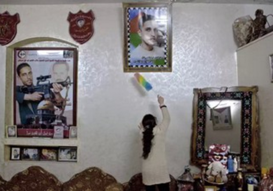 Ahlam Shibli's photo shows house of a Palestinian suicide bomber, exhibited at Jeu de Paume Museum.