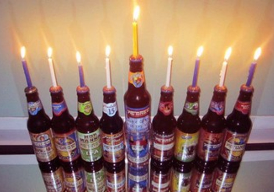 Menorah made of Shmaltz Brewing's He'Brew beer bottles