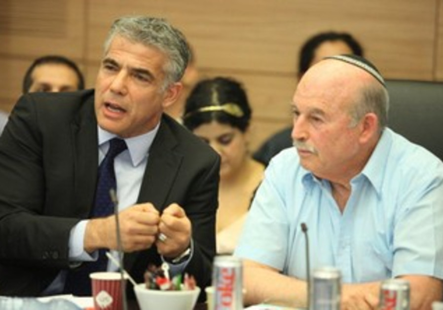 Finance Minister Yair Lapid at the Knesset's Finance Committee, June 11, 2013.