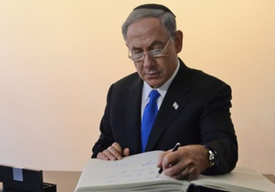 Prime Minister Binyamin Netanyahu opens an exhibition at Auschwitz, 13 June 2013.