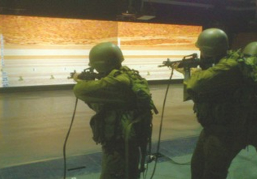 SOLDIERS HONE their shooting skills at an IDF simulation facility in the South.