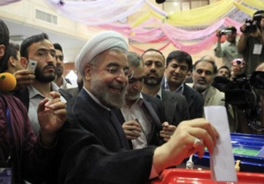 Presidential candidate Hassan Rohani casts his ballot during the 2013 Iranian presidential election.