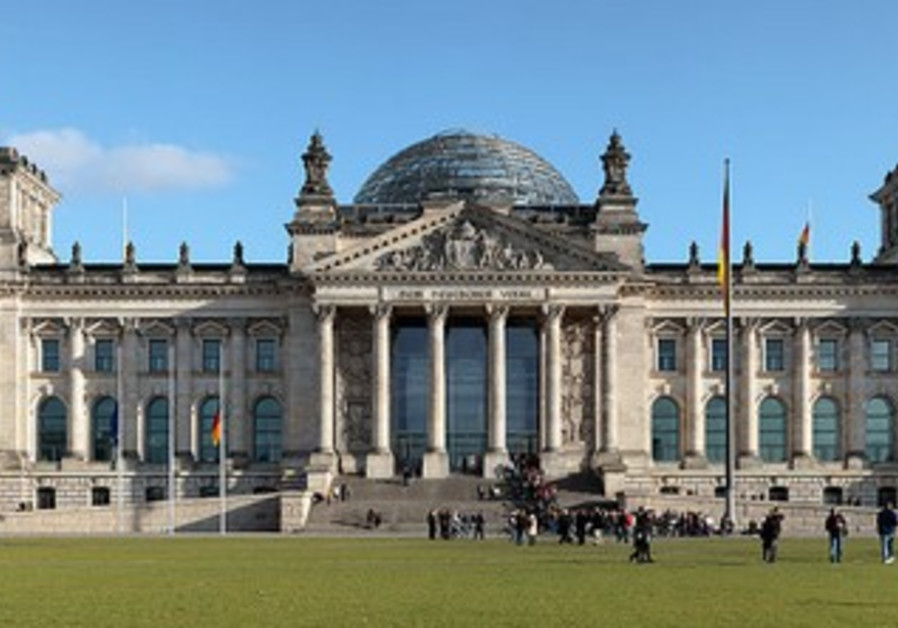"""The Reichstag building seen from the west. Inscription translates to """"For/To the German People"""""""