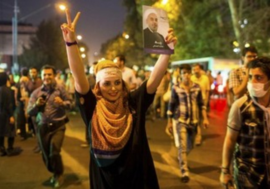 A supporter of Hassan Rohani celebrates his victory in Tehran.