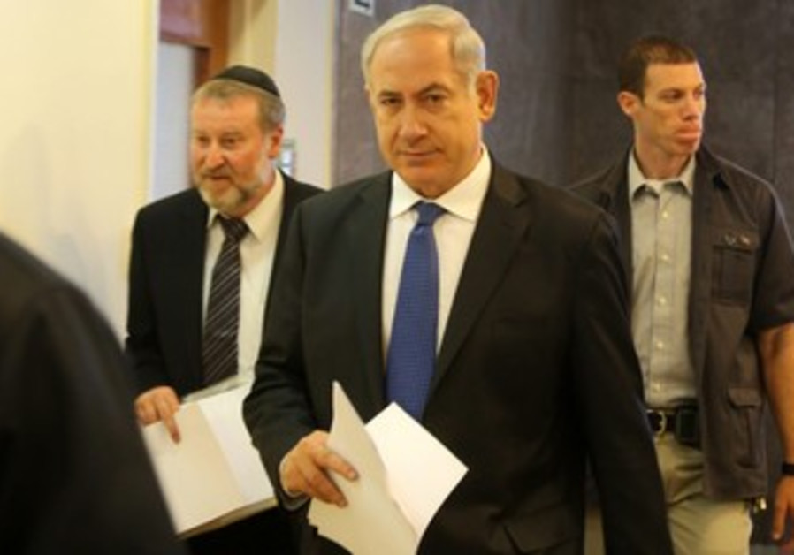 Prime Minister Binyamin Netanyahu arrives at weekly cabinet meeting, June 16, 2013