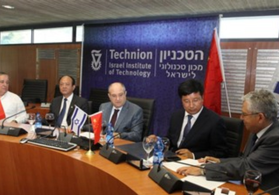 Cninese officials. Techion brass sign agreement for scholarship fund