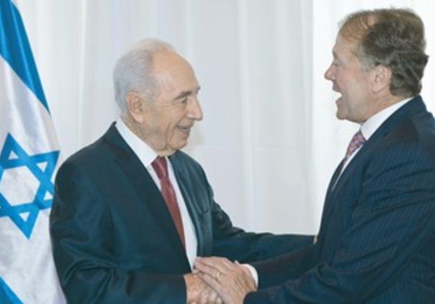 President Shimon Peres greet Cisco CEO John Chambers, ahead of celebrations for Peres's 90th