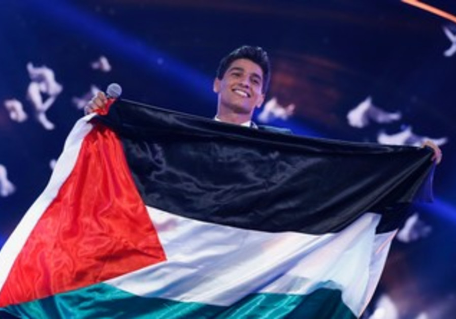 Mohammed Assaf with flag after Arab Idol win, June 22, 2013