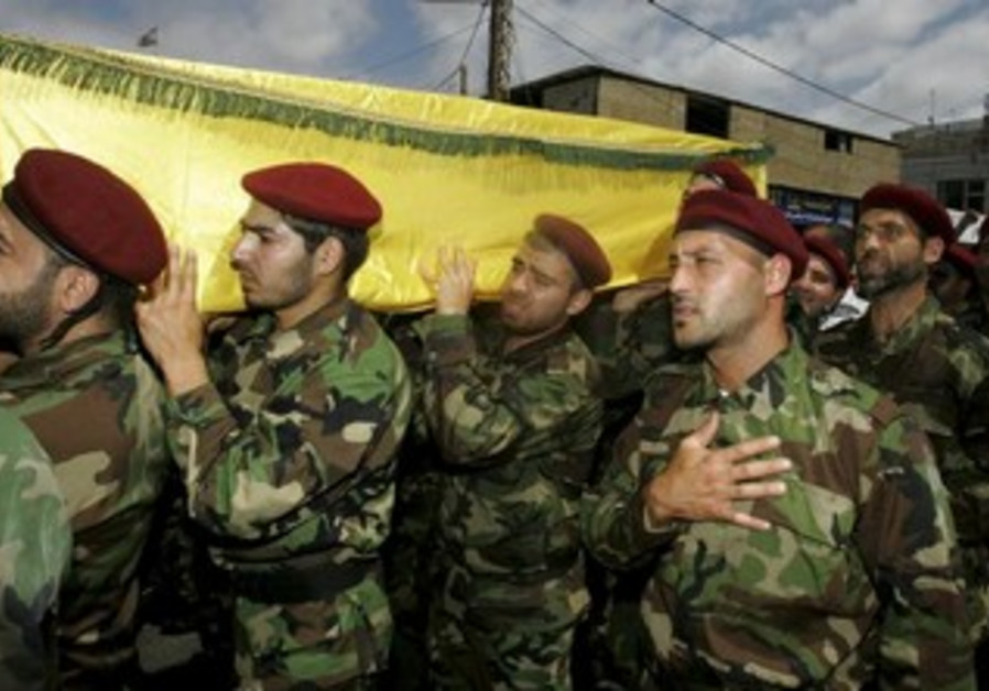 Hezbollah members at funeral of a Hezbollah fighter, May 26, 2013