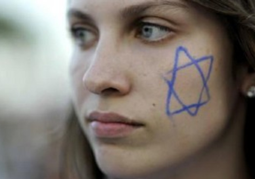 Israeli girl with star of david painted on her cheek.