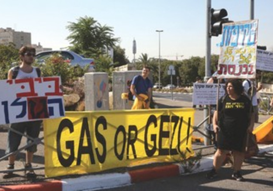 PROTESTERS AGAINST the government's natural gas policy gather outside the Prime Minister's Office