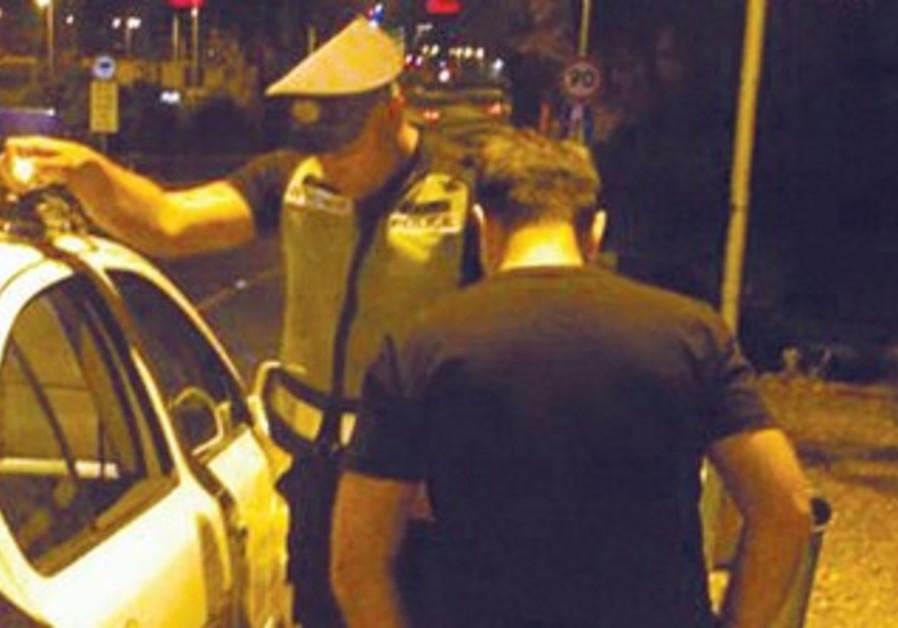 A traffic officer checks a driver in Tel Aviv