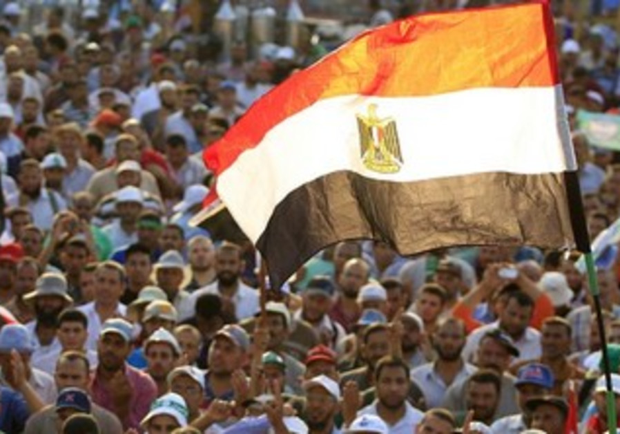Members of the Muslim Brotherhood and supporters of Egyptian President Mohamed Morsi shout slogans