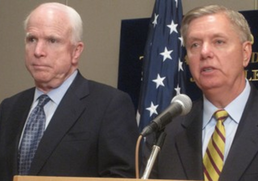 US SENATORS John McCain and Lindsey Graham address a news conference in Jerusalem, 30 June 2013.